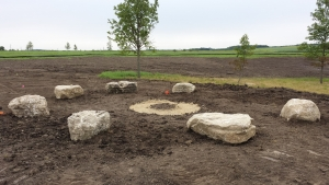 Seating stones are dug in and leveled.  Now we're ready for the firepit, finish grading and turf seed & sod!