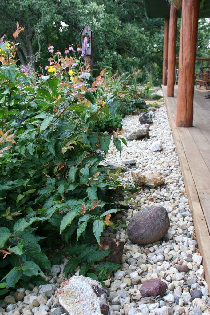 dickinson_residence_native_plants_stone_edging_albany_wi.jpg